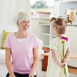 Pretty woman get surprise by her daughter — Stock Photo