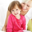 Smiling mother reading a book with children — Stock Photo