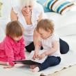 Pretty woman working with her children at laptop — Stock Photo #10827847
