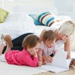 Mother reading a book with children — Stock Photo