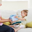 Beauty woman get surprise by her daughter — Stock Photo