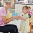 Good-looking woman get surprise by her daughter — Stock Photo