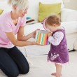 Young mother get surprise by her daughter — Stock Photo