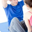 Young man doing fitness exercises with a woman — Stock Photo
