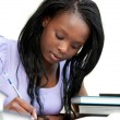 Stockfoto: Afro-americwomstudying at home