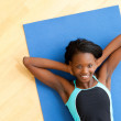 Smiling woman doing fitness - Stock Photo
