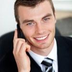 Smiling businessman using mobile phone — Stock Photo