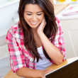 Smiling woman using laptop — Stock Photo #10828218