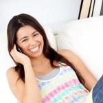 Laughing woman using phone — Stock Photo