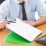 Businessman holding document — Stock Photo