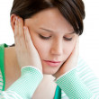 Portrait of a depressed teenager holding up her head on her hand — Stock Photo