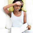 Afro-american teenager feeling sick holding a book — Stock Photo #10828558