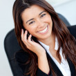 Jolly asian businesswoman talking on phone — Stock Photo #10828597
