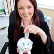 Positive caucasian businesswoman holding piggybank — Stock Photo #10828629