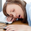 Tired young woman sleeping in her office — Foto de Stock