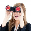 Fascinated young businesswoman looking through a spyglass — Stock Photo #10828731