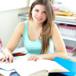 Captivating brunette student doing her homework — Foto de Stock