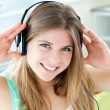 Jolly caucasian woman listen to music with headphones - Stock Photo