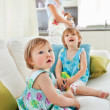 Blond mother having fun with her young daughters - Stock Photo