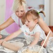 Concentrated woman baking with her daughter — Stock Photo #10829410
