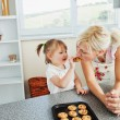 Pretty mother baking cookies with her daughter — Stock Photo