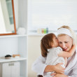 Happy mother taking care of her children — Stock Photo