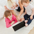 Cute family having fun with a laptop - Stock Photo