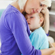 Blond woman taking care of her child — Stock Photo
