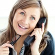 Confident young businesswoman talking on phone sitting — Stock Photo