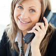 Portrait of a beautiful businesswoman talking on phone — Stock Photo