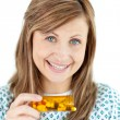 Smiling young woman taking pills — Stock Photo
