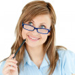 Thoughtful businesswoman holding a pen — Stock Photo #10829813