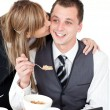 Stock Photo: Beautiful blond businesswomgiving her smiling boyfriend kis