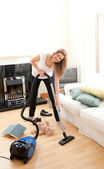 Handsome woman cleaning her living room — Stock Photo