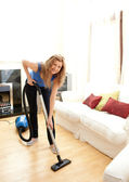 Smiling woman use vacuum cleaner — Stock Photo