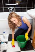 Unhappy woman cleaning the ground — Stock Photo
