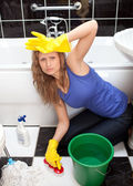 Exhausted woman in a bathroom — Stock Photo