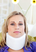 Portrait of a woman with a neck brace — Stock Photo