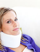 Young woman with a neck brace looking in the camera — Stock Photo