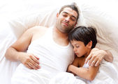 Caring father with his son asleep — Stock Photo