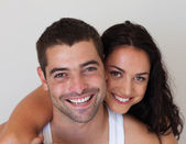 Portrait of a blissful couple against white background — Stock Photo
