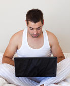 Concentrated man using laptop — Stock Photo
