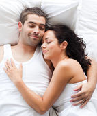 Boyfriend and girlfriend together in bed — Stock Photo