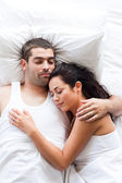 Attractive couple sleeping — Stockfoto
