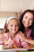 Portrait of a protective mother with smiling daughter — Stock Photo