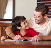Cute boy looking at his father — Stock Photo