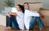 Delighted couple moving house — Stock Photo