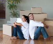 Glowing couple relaxing after buying a house — Stock Photo
