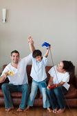 Young family celebrating — Stock Photo