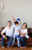 Cute boy plays with his parents video games — Stock Photo